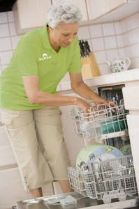Caregiver doing dishes
